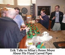 Erik Talks to Milan's Renee Meyer About His Hand Carved Pipes While Nicholas, Alan, and Scott Listen