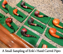 A Small Sampling of Erik's Hand Carved Pipes are Displayed at the Tobacco Bar