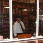 A Customer Selects from a Wide Array of Premium Cigars for His Lunchtime Smoke